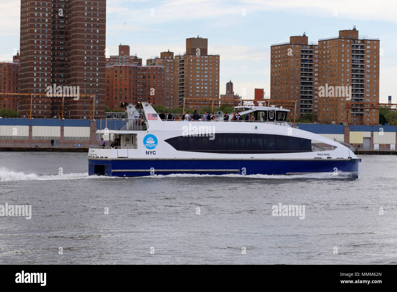 A NYC Ferry boat on the East River - Stock Image