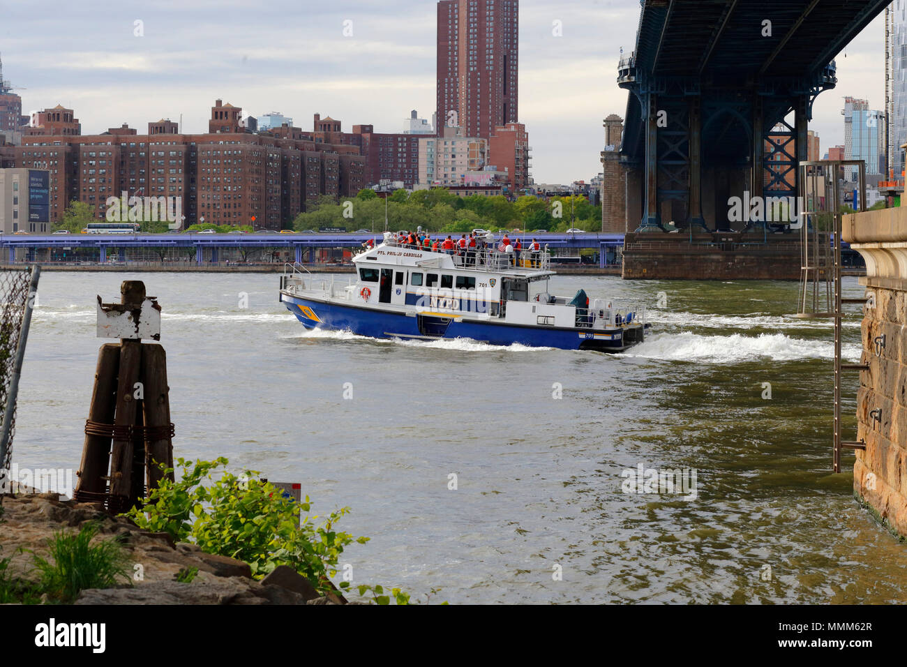 NYPD Harbor Boat Ptl. Phillip Cardillo on a sightseeing cruise of the East River - Stock Image