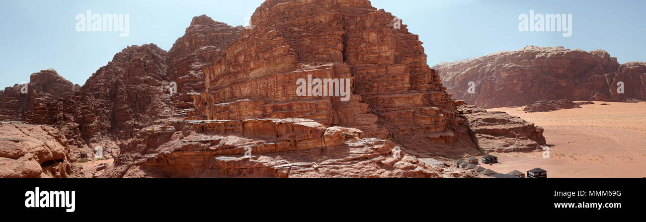 Composite panorama of high resolution aerial photos of a monolithic mountain in the central area of the desert reserve of Wadi Rum, Jordan, middle eas - Stock Image