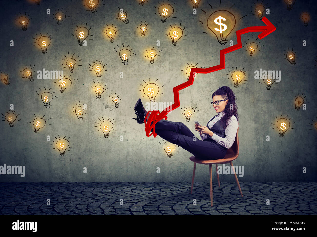 young accomplished business woman relaxing sitting in the office under idea money rain - Stock Image