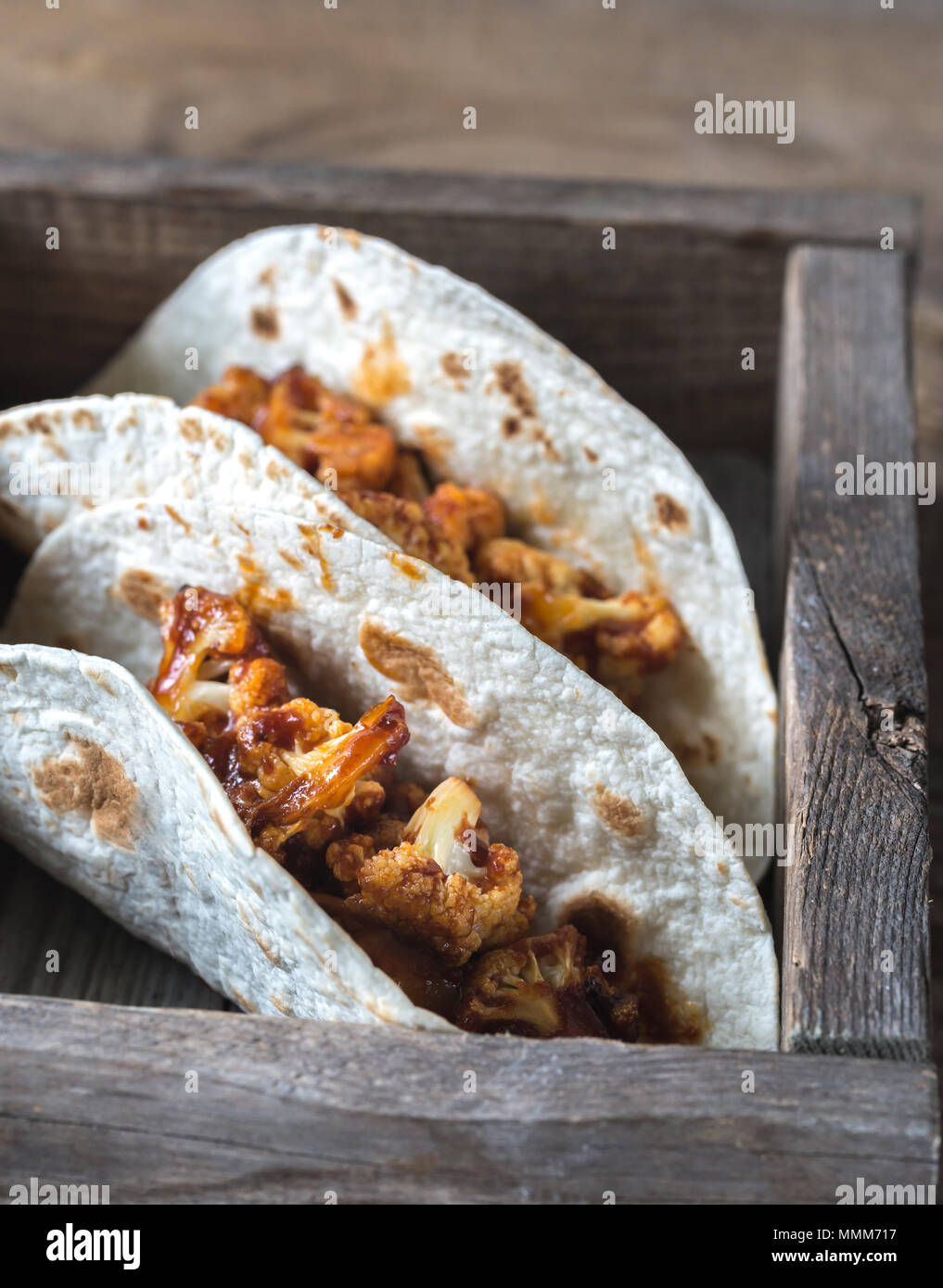 Tacos with spicy cauliflower - Stock Image