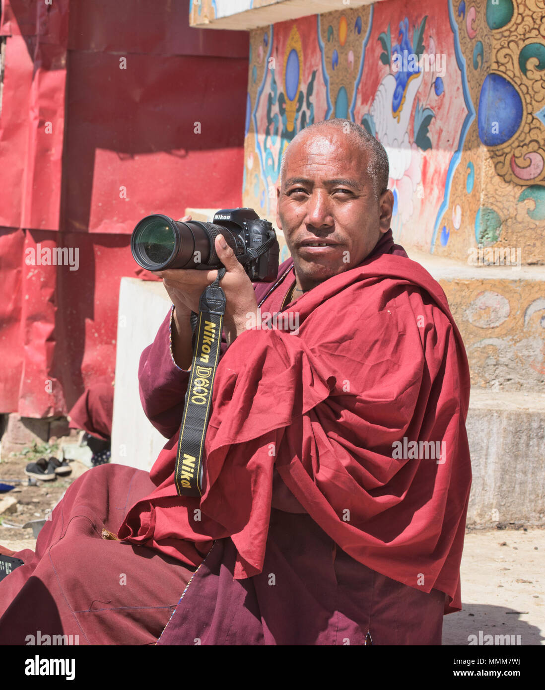 The Nikon monk, Yarchen Gar, Sichuan, China - Stock Image