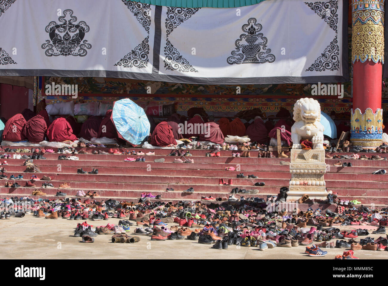 Collection of shoes outside the monastery, Yarchen Gar, Sichuan, China - Stock Image