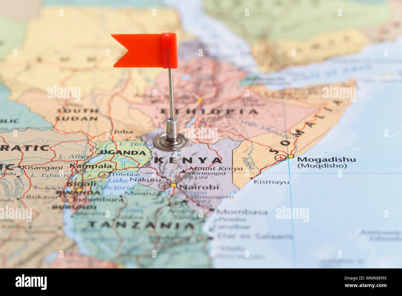 Small red flag marking the African country of Kenya on a world map on liberia world map, tanzania world map, turkey world map, jamaica world map, rwanda world map, malawi world map, madagascar world map, ethiopia world map, africa world map, indonesia world map, uae world map, portugal world map, lesotho world map, guatemala world map, nigeria world map, iran world map, uganda world map, algeria world map, kuwait world map, mozambique world map,