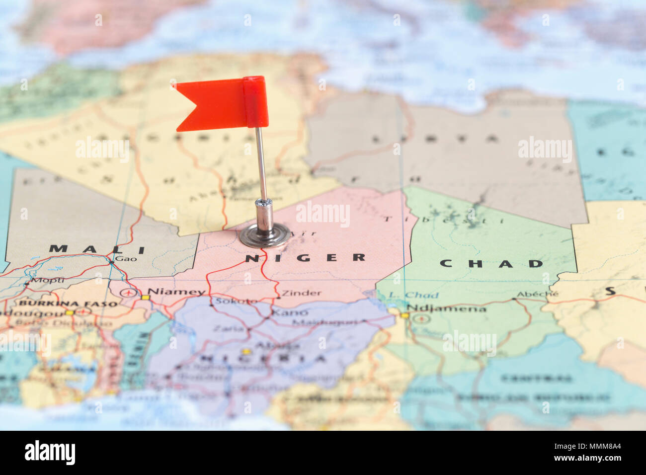 Small Red Flag Marking The African Country Of Niger On A World Map