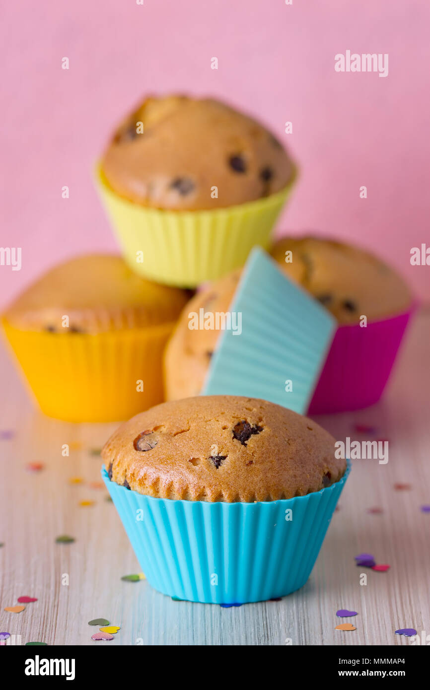 Homemade cupcakes with bright colored silicone molds - Stock Image