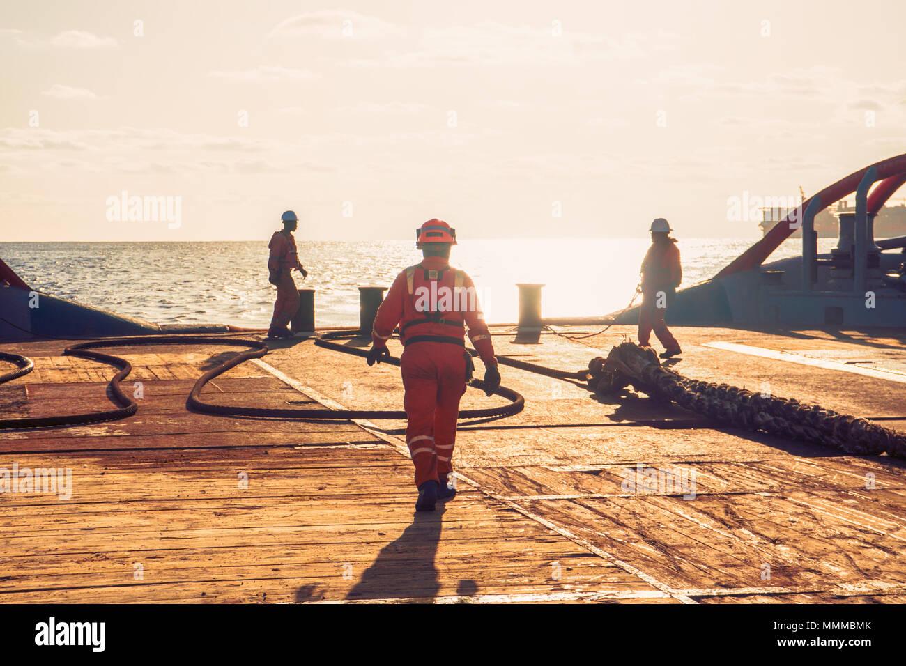 Anchor-handling Tug Supply AHTS vessel crew preparing vessel for