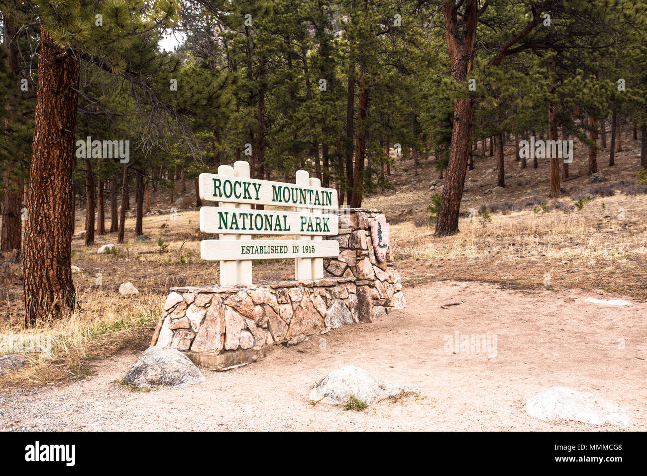 View from Rocky Mountain National Park in Colorado with sign indicating entrance from Estes Park gate - Stock Image