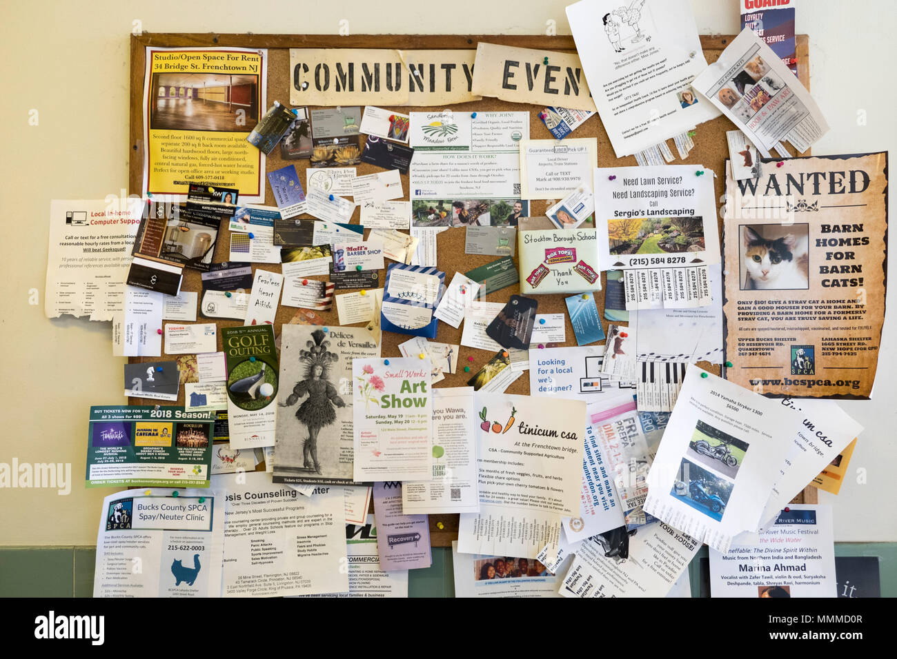 Community Bulletin board with postings in a small town post office, Stockton, New Jersey, USA - Stock Image
