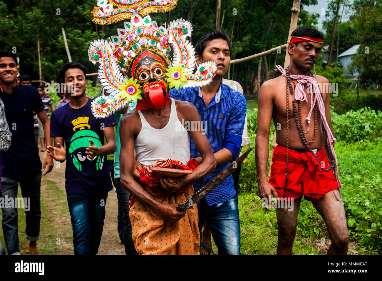 A group of Hindu devotees perform the rituals of Charak Puja festival at Tangail in Bangladesh on April 14, 2018. - Stock Image