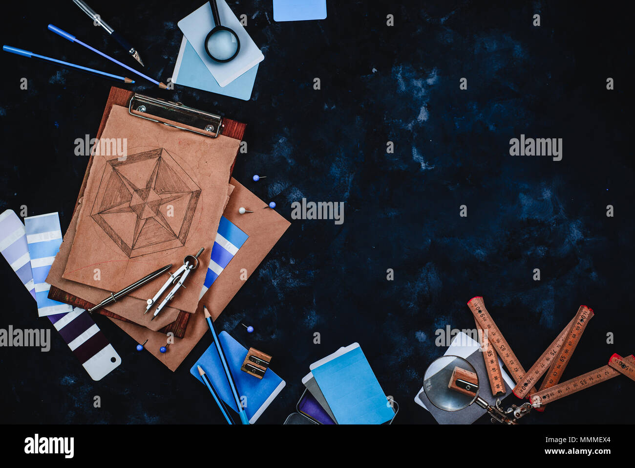 Contractor and architecture concept with craft paper, sketches, compasses, rulers, clipboards and pencils on a dark stone background with copy space. - Stock Image