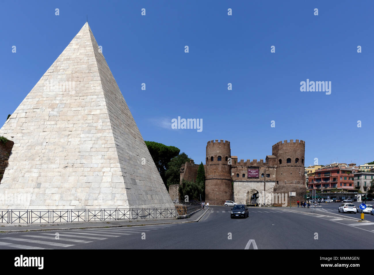 The Pyramid of Caius Cestius and the twin towered Porta San Paolo in the Rome neighbourhood of Testaccio. The Pyramid (Piramide di Caio Cestio) was bu Stock Photo