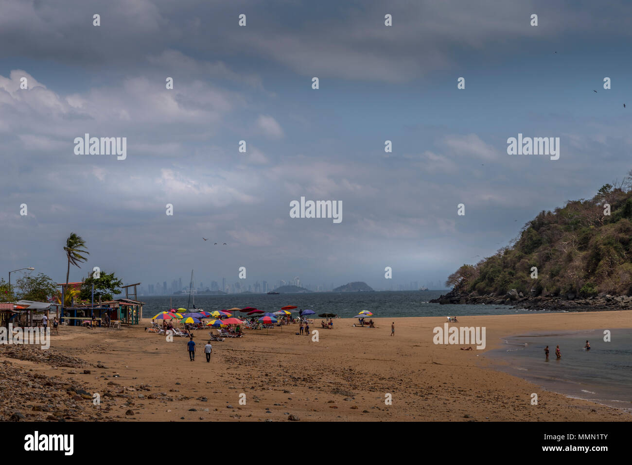 beach scene on taboga island with the skyline of panama city in the