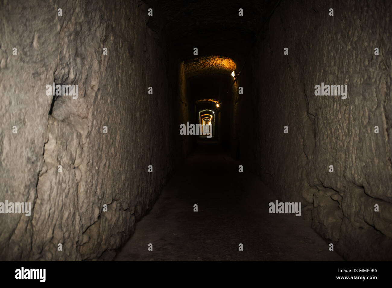 An underground tunnel in Fort Rinella, Kalkara Malta giving the impression of a never-ending walk. - Stock Image
