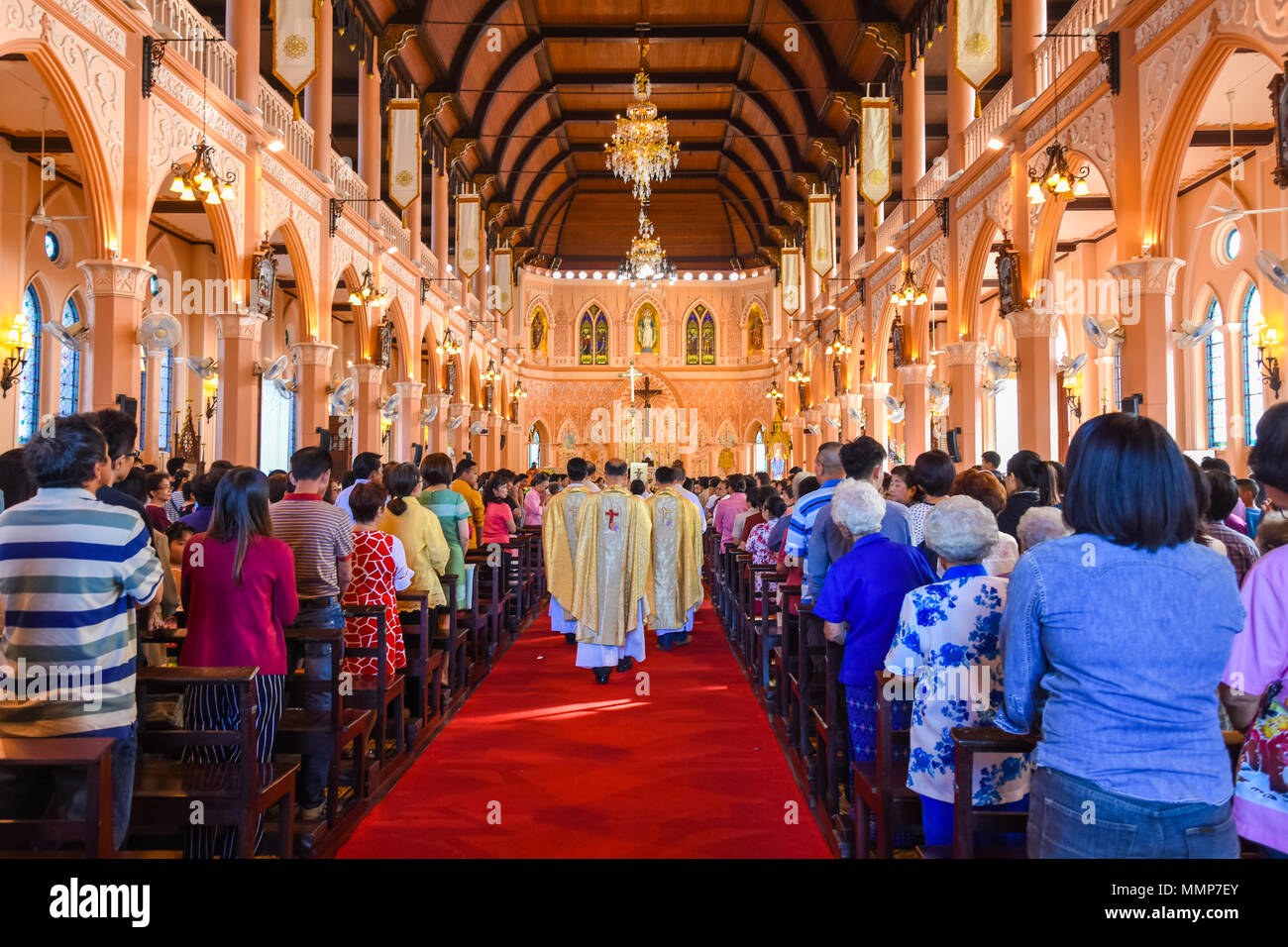 Chantaburi, Thailand - January 1, 2016: Group of pastors walking into Christian beautiful church where Chistian people attending religion ceremony in  - Stock Image