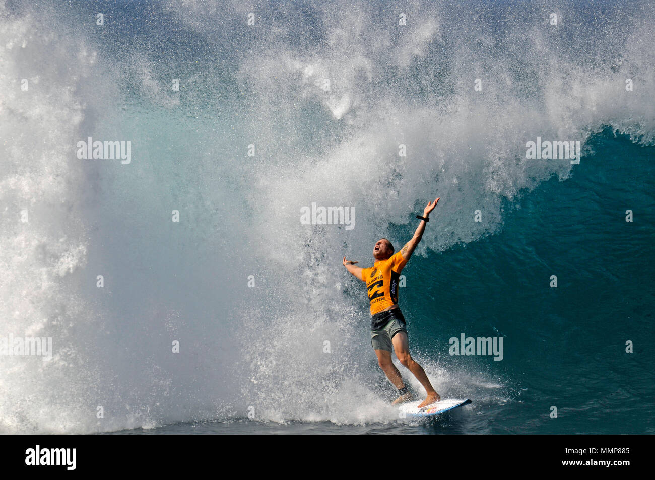 Professional surfer Mick Fanning celebrates surfing a big wave during the Billabong Pipe Masters Championship 2015, North Shore, Oahu, Hawaii - Stock Image