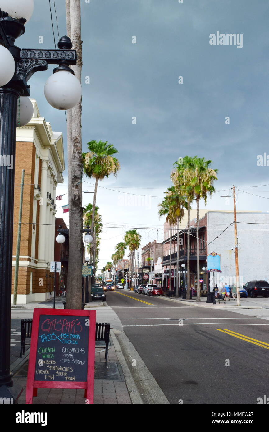 Downtown Ybor City in Tampa's oldest, historical neighborhood.  Building restored, original artwork and retro stores of art, cigars, hookahs and food. - Stock Image