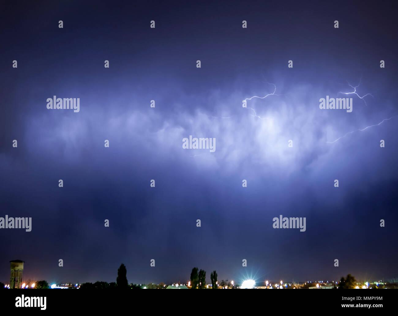 Lightning flash over a city, Thunderstorm , electricity blast storm Stock Photo