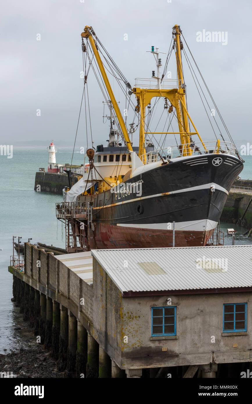 a deep sea fishing trawler on a slipway at newlyn harbour in cornwall on the cornish coast. - Stock Image
