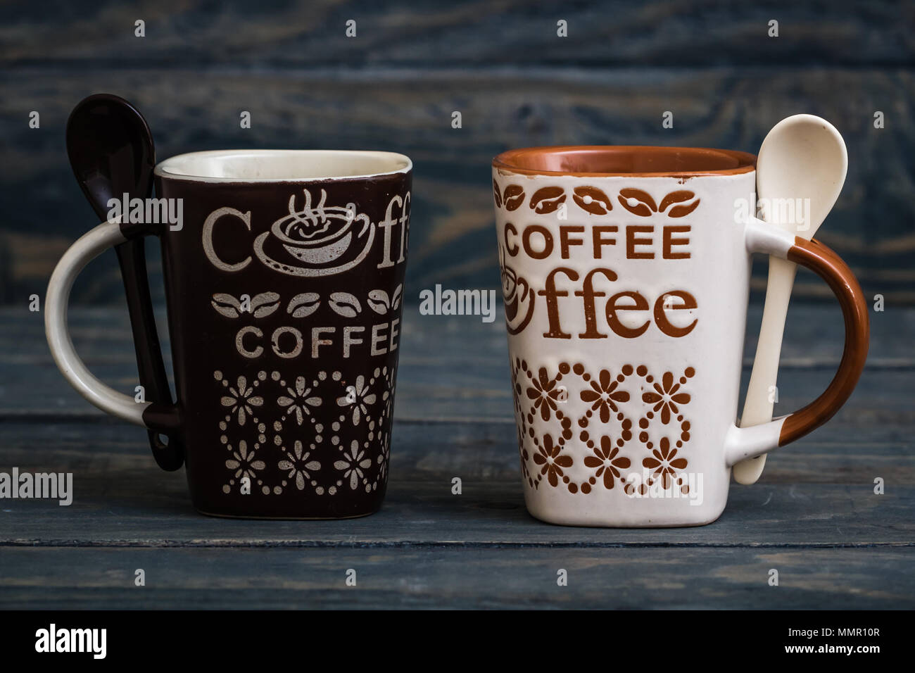 211ae699c03 White, brown ceramic coffee mugs on wooden background Stock Photo ...