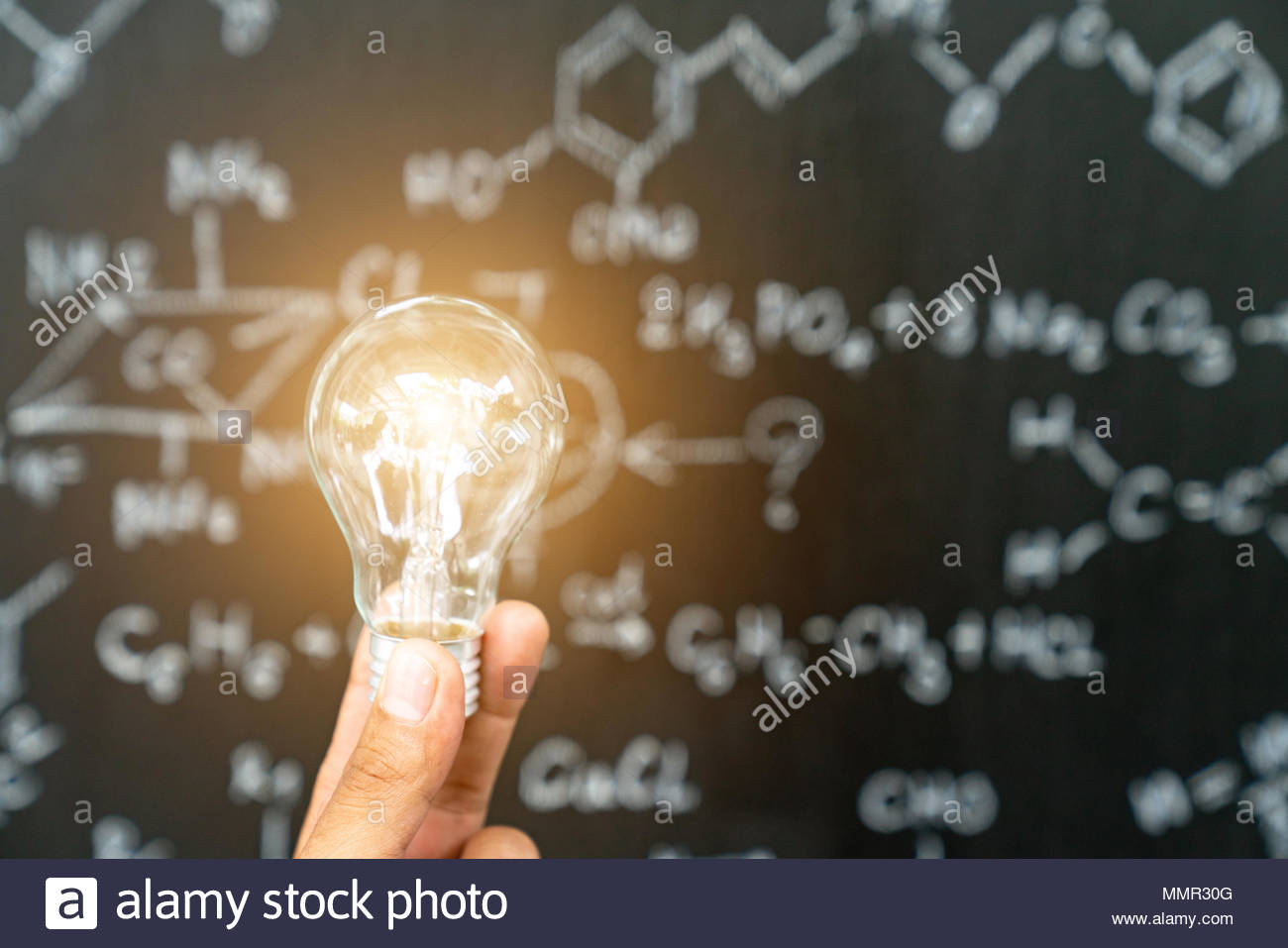 Light bulb glowing learning from mistake - Stock Image
