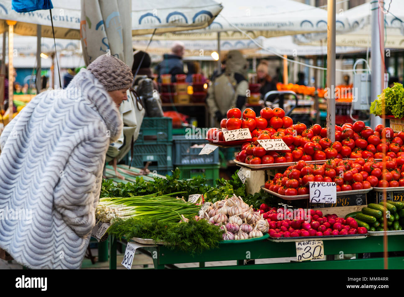Woman looking at vegetables, Riga central market, Latvia - Stock Image