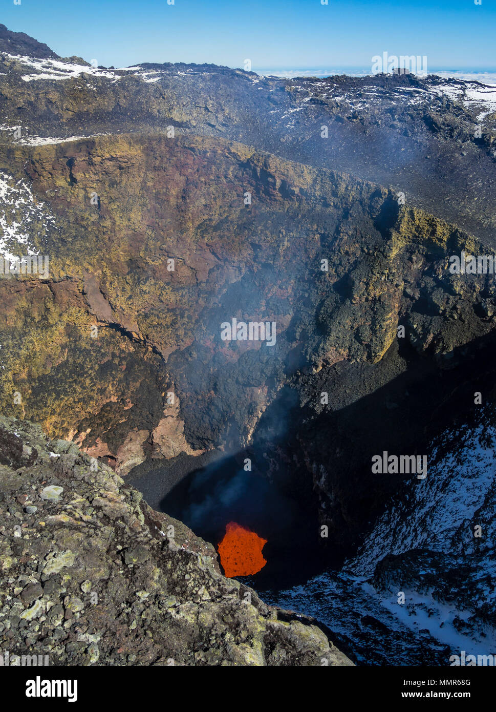 View into the crater of volcano Villarica, red magma, lava,eruptions,   Chile - Stock Image