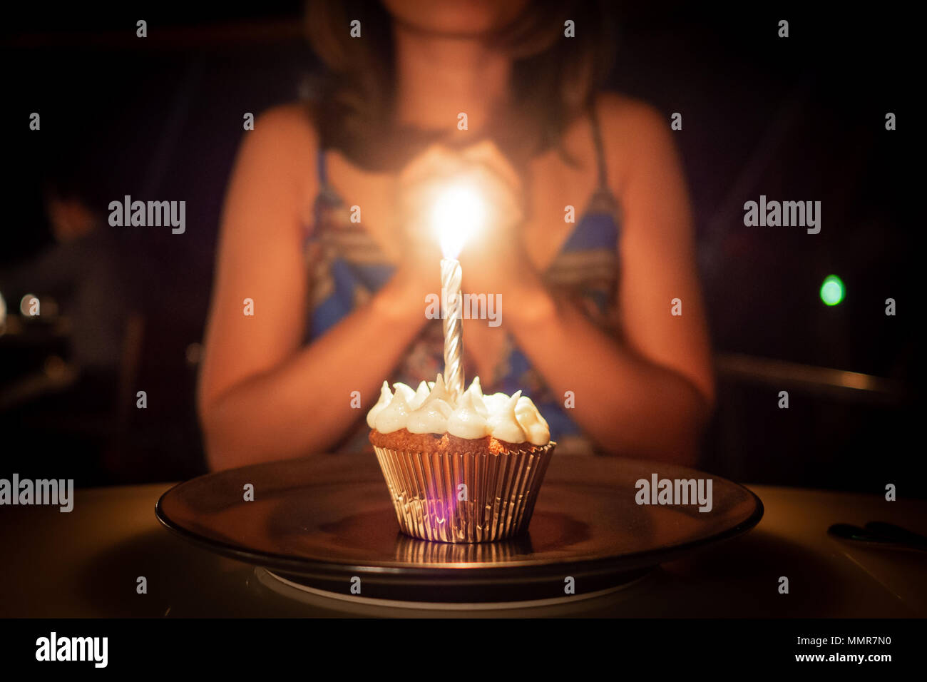 Young woman making a wish on your birthday - Stock Image