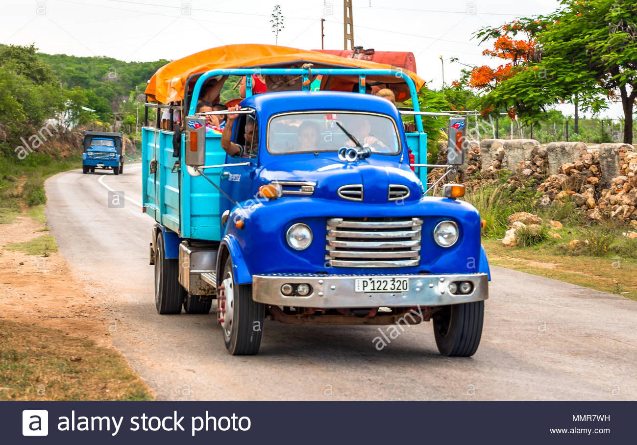 Old American cars or vehicles in working condition circulating in the Cuban road and streets. - Stock Image