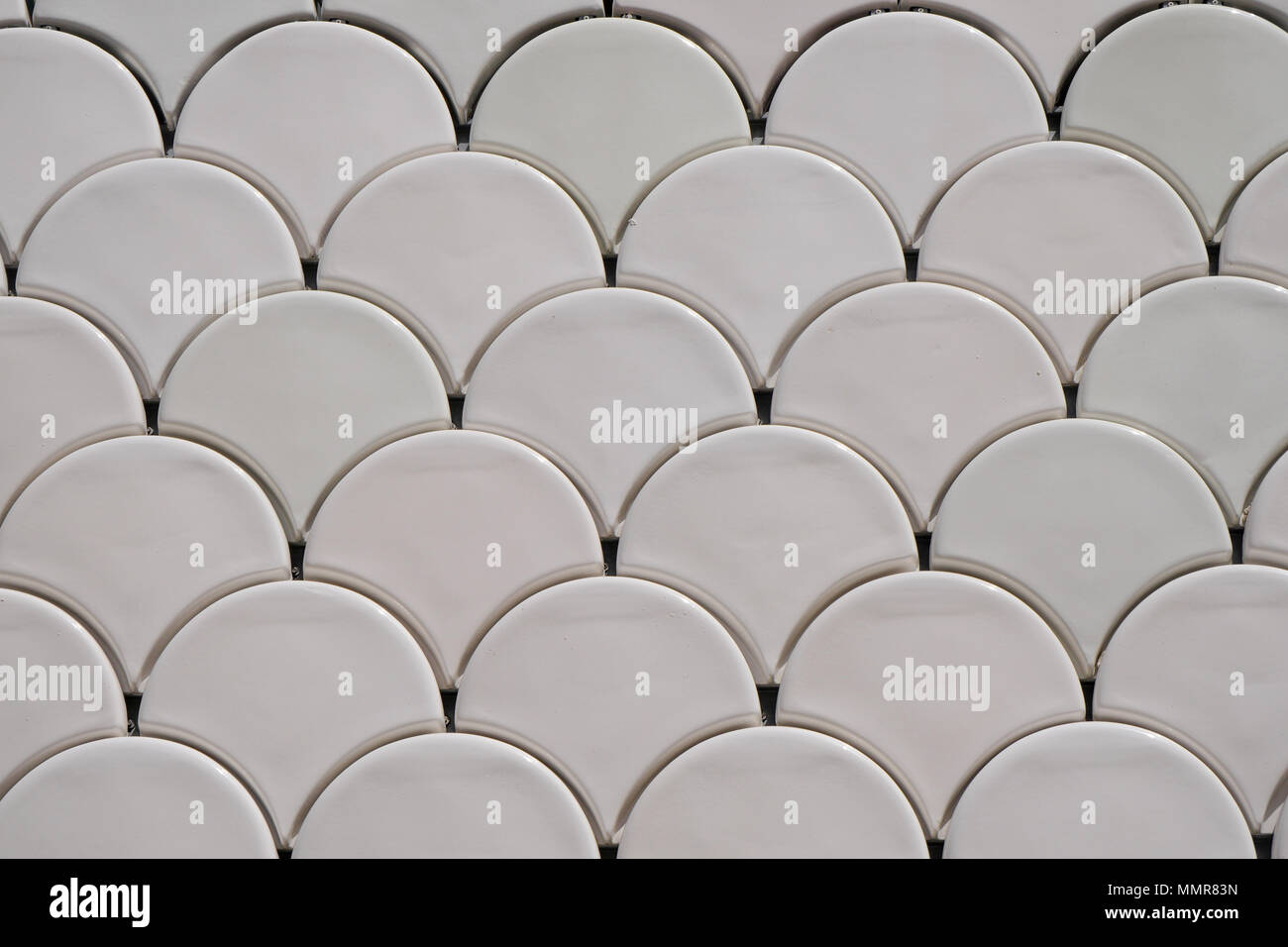 Tiles shaped like fish scales, Lisbon Oceanarium admittance building, Park of the Nations district, Portugal - Stock Image