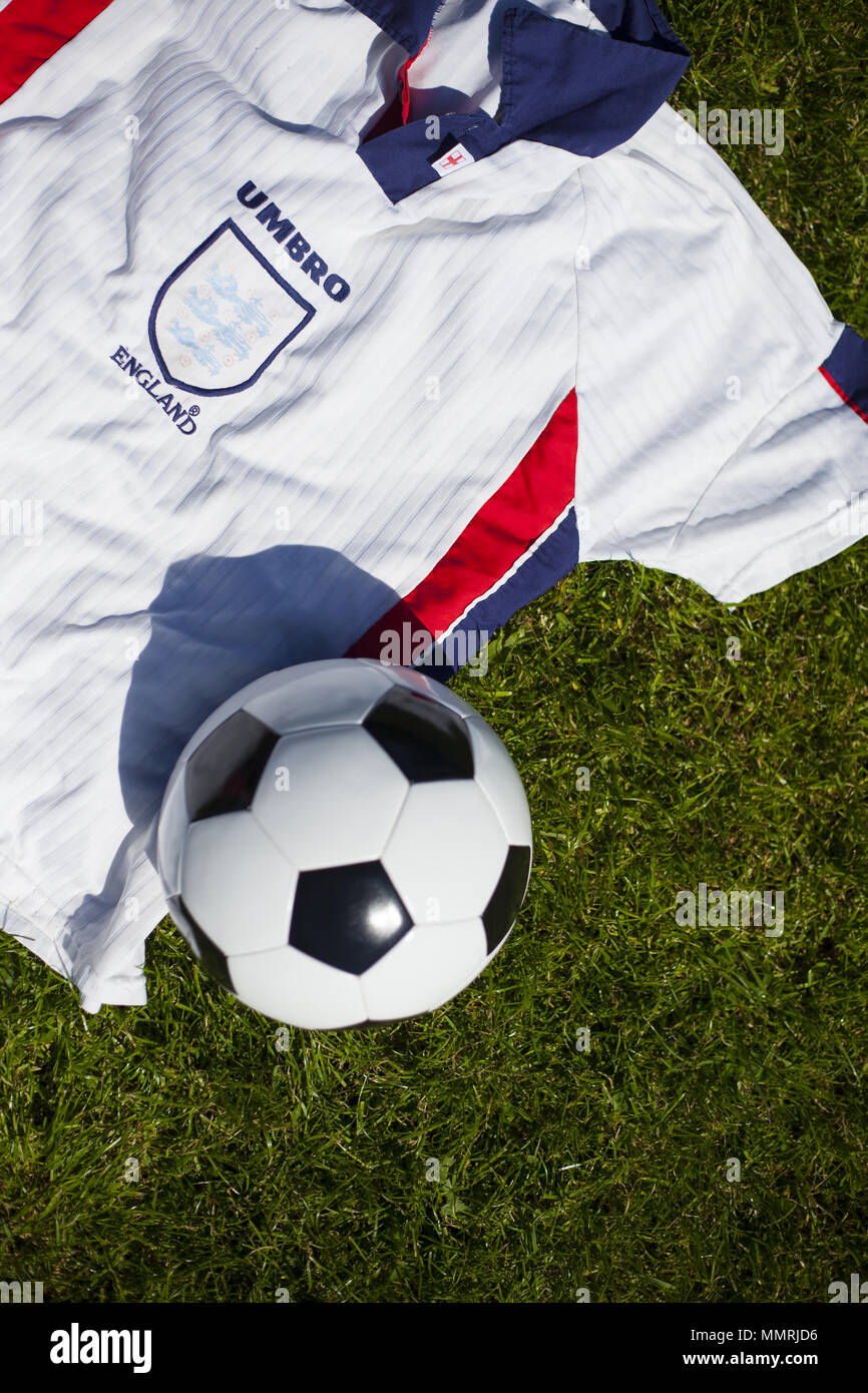 A black and white football with England team shirt - Stock Image