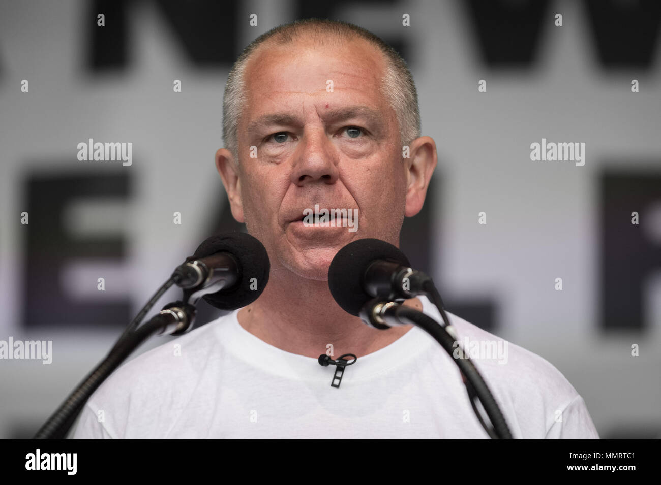 London, UK. 12th May, 2018. Tim Roache, General Secretary of GMB Union, speaks to a crowd of  thousands of trade unionists during a TUC rally in Hyde Park on the theme of 'a new deal for working people', aimed against government austerity and injustice. Credit: Guy Corbishley/Alamy Live News - Stock Image