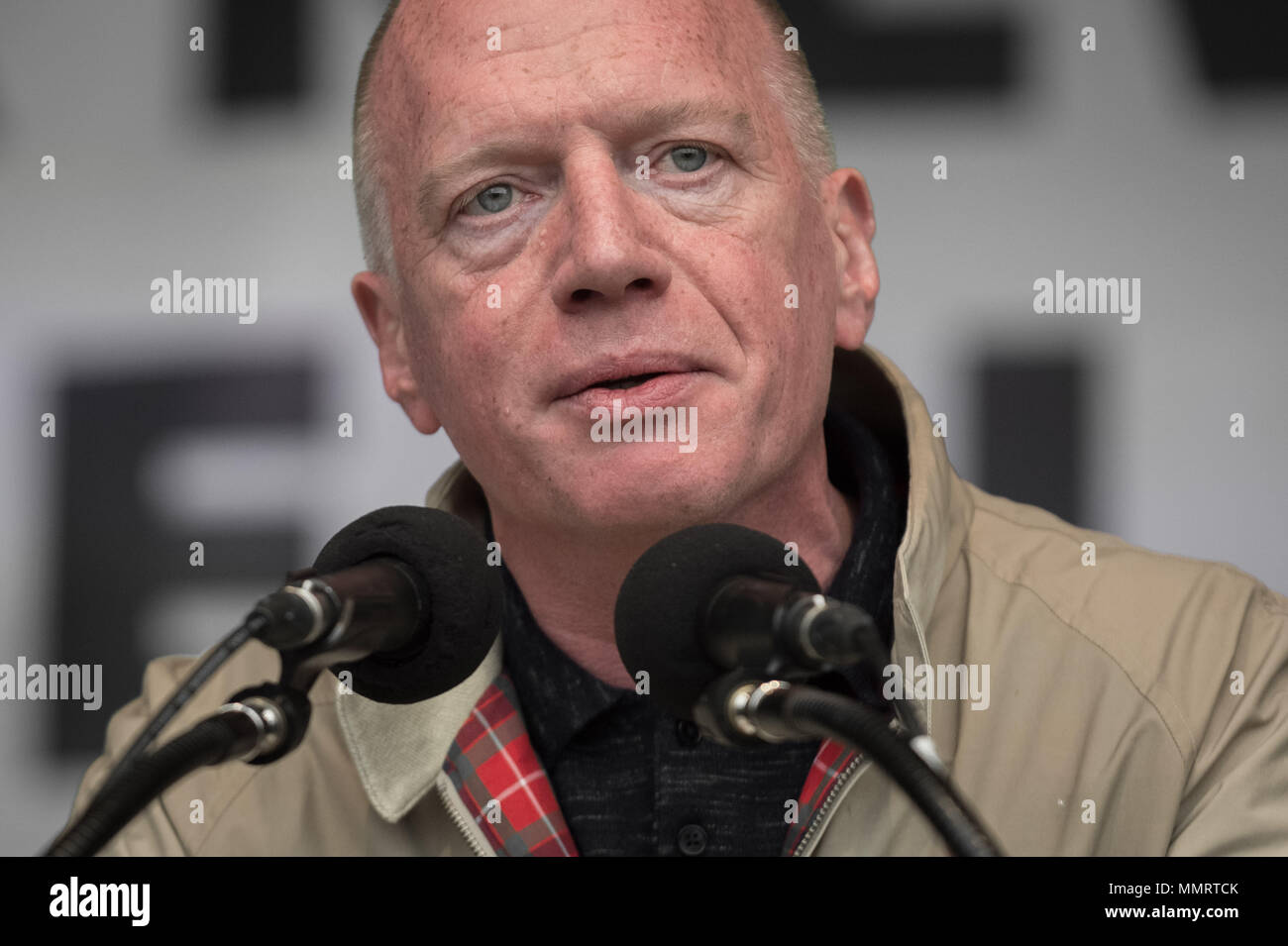 London, UK. 12th May, 2018. Matt Wrack, General Secretary of the Fire Brigades Union(FBU), speaks to a crowd of  thousands of trade unionists during a TUC rally in Hyde Park. Credit: Guy Corbishley/Alamy Live News - Stock Image