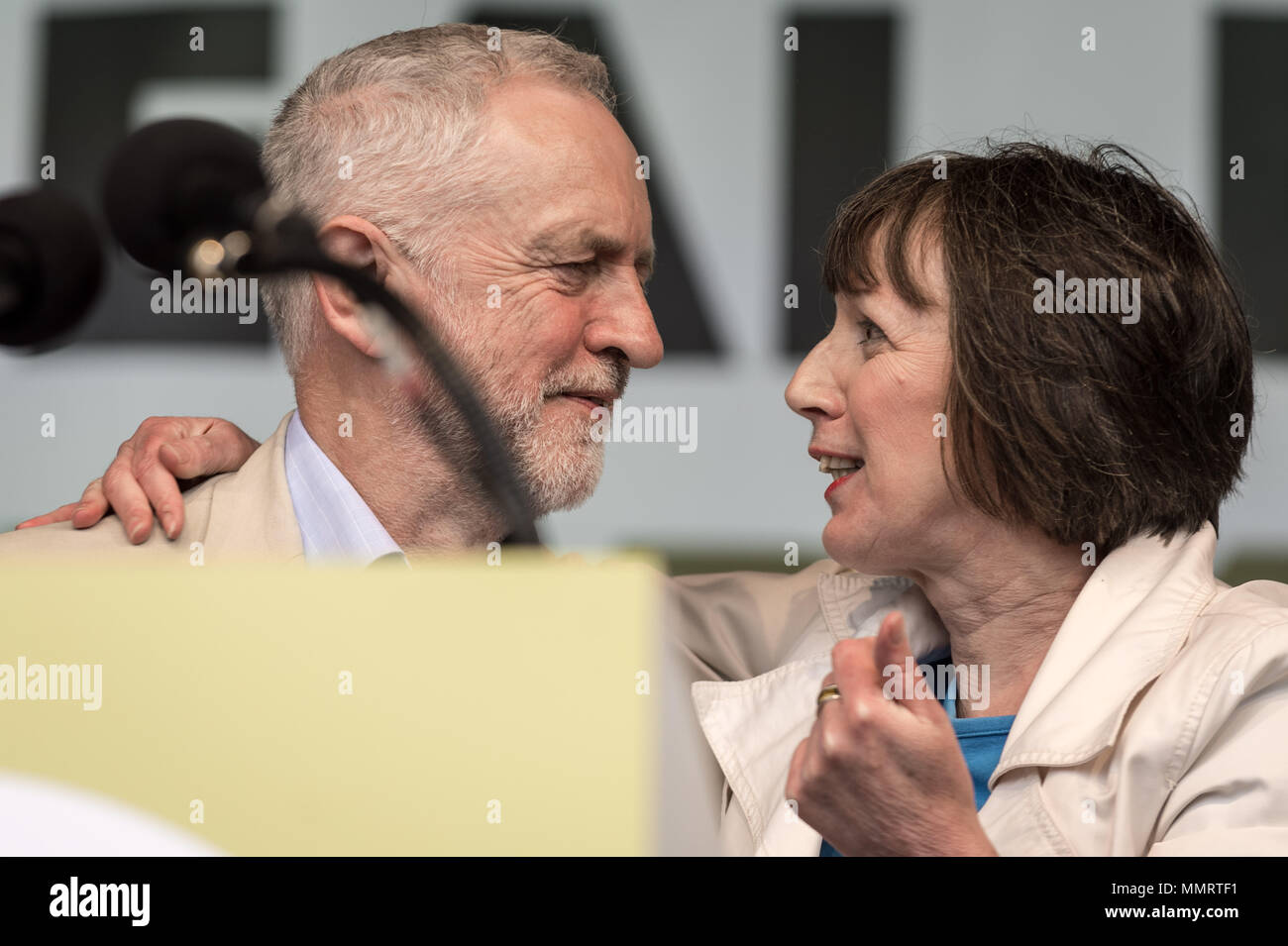 London, UK. 12th May, 2018. Jeremy Corbyn(L), The Labour Party leader, speaks with TUC General Secretary Frances O'Grady, after giving a speech to a crowd of  thousands of trade unionists during a TUC rally in Hyde Park. Credit: Guy Corbishley/Alamy Live News - Stock Image