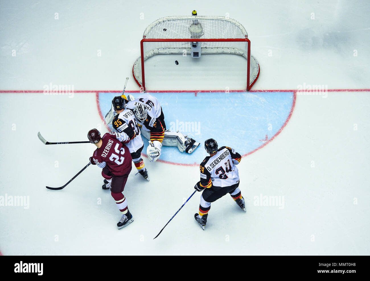Herning, Denmark.. 12th May, 2018. (LR) Andris Dzerins of Team Latvia, Frederik Tiffels, Niklas Treutle and Dennis Seidenberg of Team Germany during the match between Latvia and Germany on 12.05.2018 in Herning, Denmark. (Photo by Marco Leipold/City-Press GbR) | usage worldwide Credit: dpa picture alliance/Alamy Live News Stock Photo