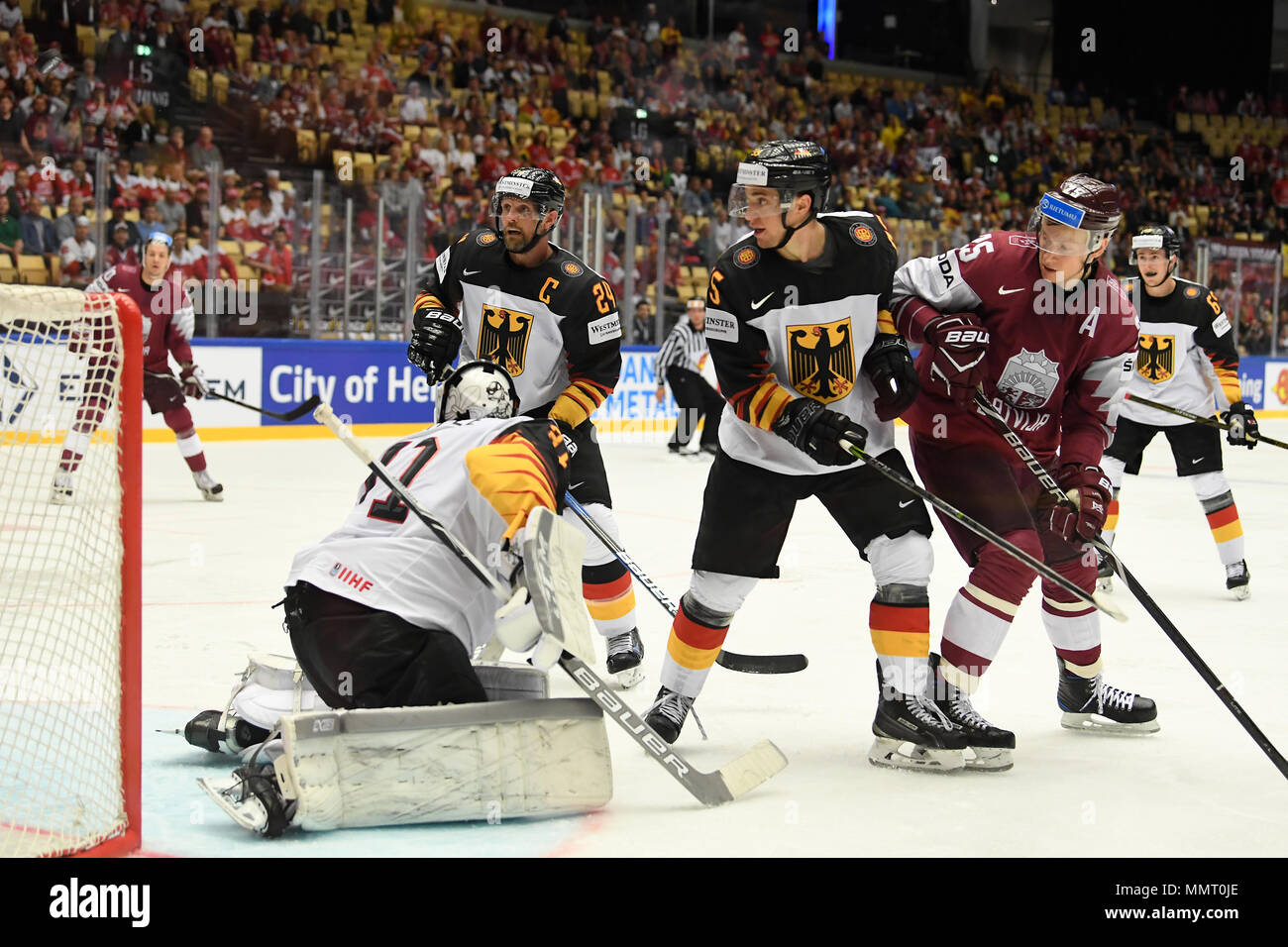 Herning, Denmark.. 12th May, 2018. (LR) Dennis Seidenberg, Niklas Treutle, Frederik Tiffels of Team Germany and Andris Dzerins of Team Latvia during the match between Latvia and Germany on 12.05.2018 in Herning, Denmark. (Photo by Marco Leipold/City-Press GbR) | usage worldwide Credit: dpa picture alliance/Alamy Live News Stock Photo