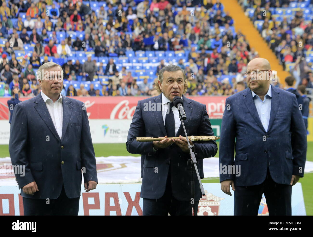 Rostov On Don, Russia. 13th May, 2018. ROSTOV-ON-DON, RUSSIA - MAY 13, 2018: Rostov-on-Don Region Governor Vasily Golubev (C) speaks at a ceremony to open Rostov Arena Stadium ahead of a 2017/2018 Russian Football Premier League Round 30 match between FC Rostov and FC Ural, the third trial for the venue to host ahead of the 2018 FIFA World Cup. Valery Matytsin/TASS Credit: ITAR-TASS News Agency/Alamy Live News Stock Photo