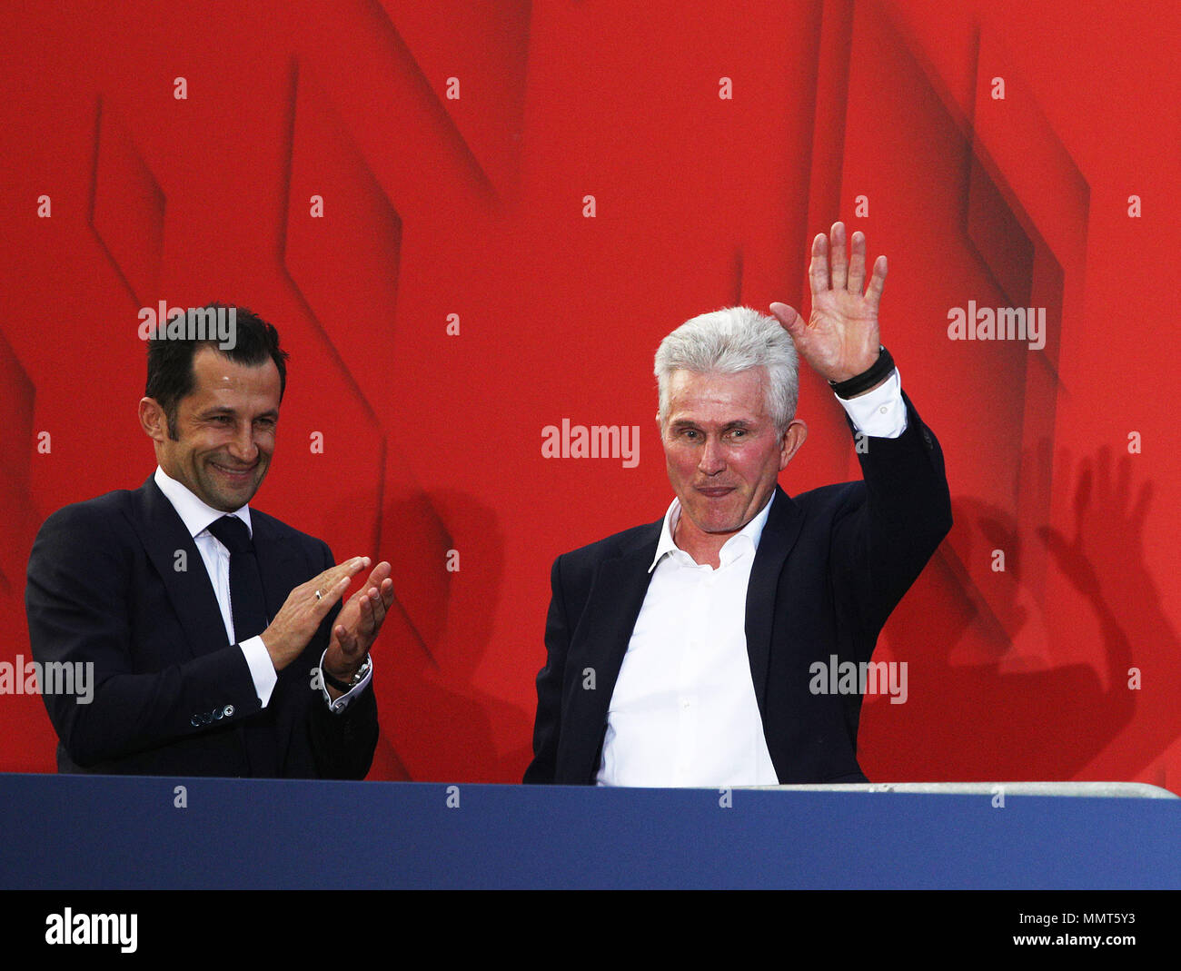 HANDOUT - 12 May 2018, Germany, Munich: Jupp Heynckes (R), coach of FC Bayern Munich, and sporting director Hasan Salihamidzic celebrate winning the championship together with the fans at the Paulaner beer garden at the Nockherberg. Earlier though, a home defeat dampened the joy over the 28th championship title. Photo: Adam Pretty/FCB/Getty Images /dpa - ATTENTION: editorial use only and only if the credit mentioned above is referenced in full Credit: dpa picture alliance/Alamy Live News Stock Photo