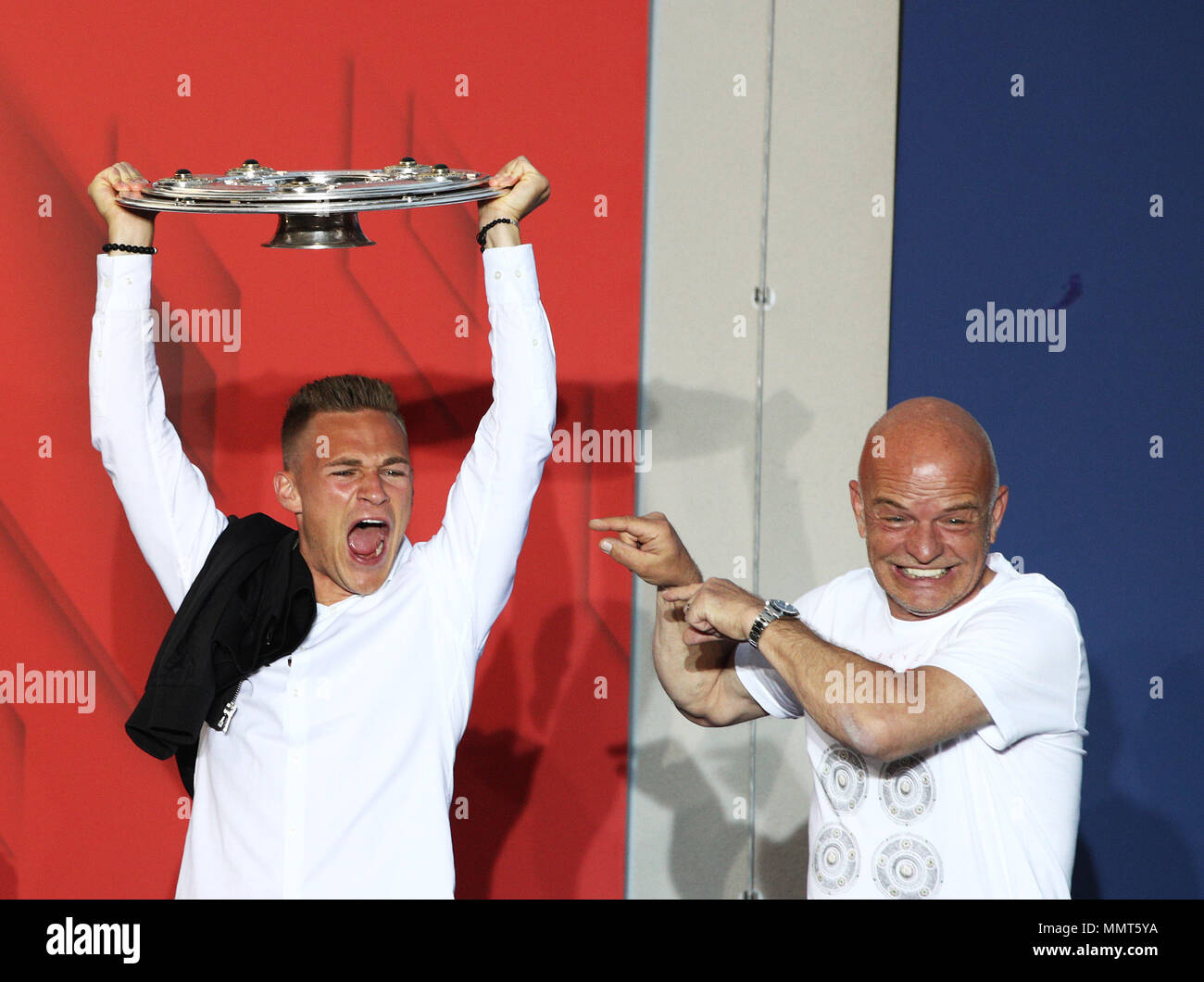 HANDOUT - 12 May 2018, Germany, Munich: Joshua Kimmich (L), player of FC Bayern Munich, celebrates winning the championship together with the fans at the Paulaner beer garden at the Nockherberg. Earlier though, a home defeat dampened the joy over the 28th championship title. Photo: Adam Pretty/FCB/Getty Images /dpa - ATTENTION: editorial use only and only if the credit mentioned above is referenced in full Credit: dpa picture alliance/Alamy Live News Stock Photo