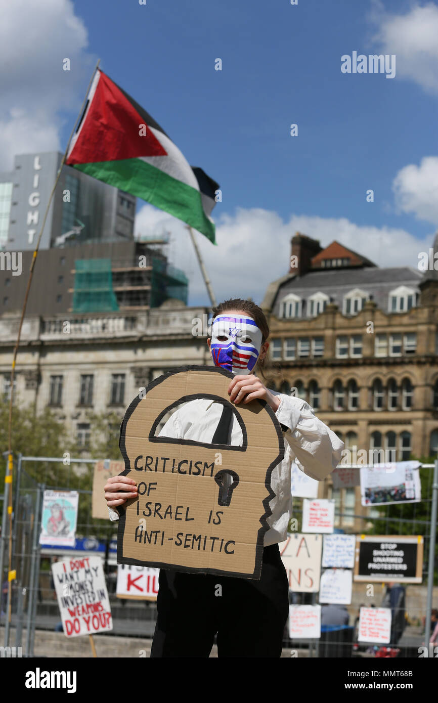 Manchester, UK. 13th May, 2018. Street theatre with a campaigner holding up a sign which reads 'Criticism of Israel is anti semetic'at second day of remembering Nakba Day which commemorates the displacement of Palestinians in 1948, when the Israeli state was founded.Piccadilly Gardens, Manchester,13th May, 2018 (C)Barbara Cook/Alamy Live News Credit: Barbara Cook/Alamy Live News - Stock Image