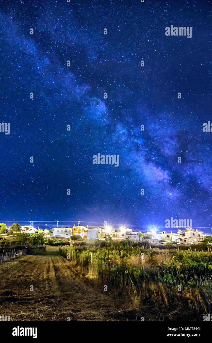 Archanes, Crete - Greece. The milky way above Archanes village - Stock Image