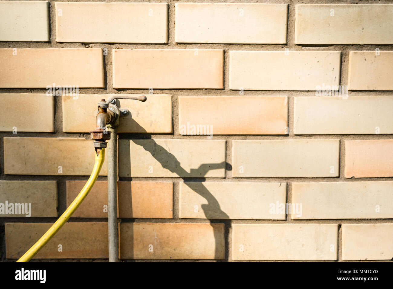 Water Tap With Yellow Garden Hose Stock Photos & Water Tap With ...
