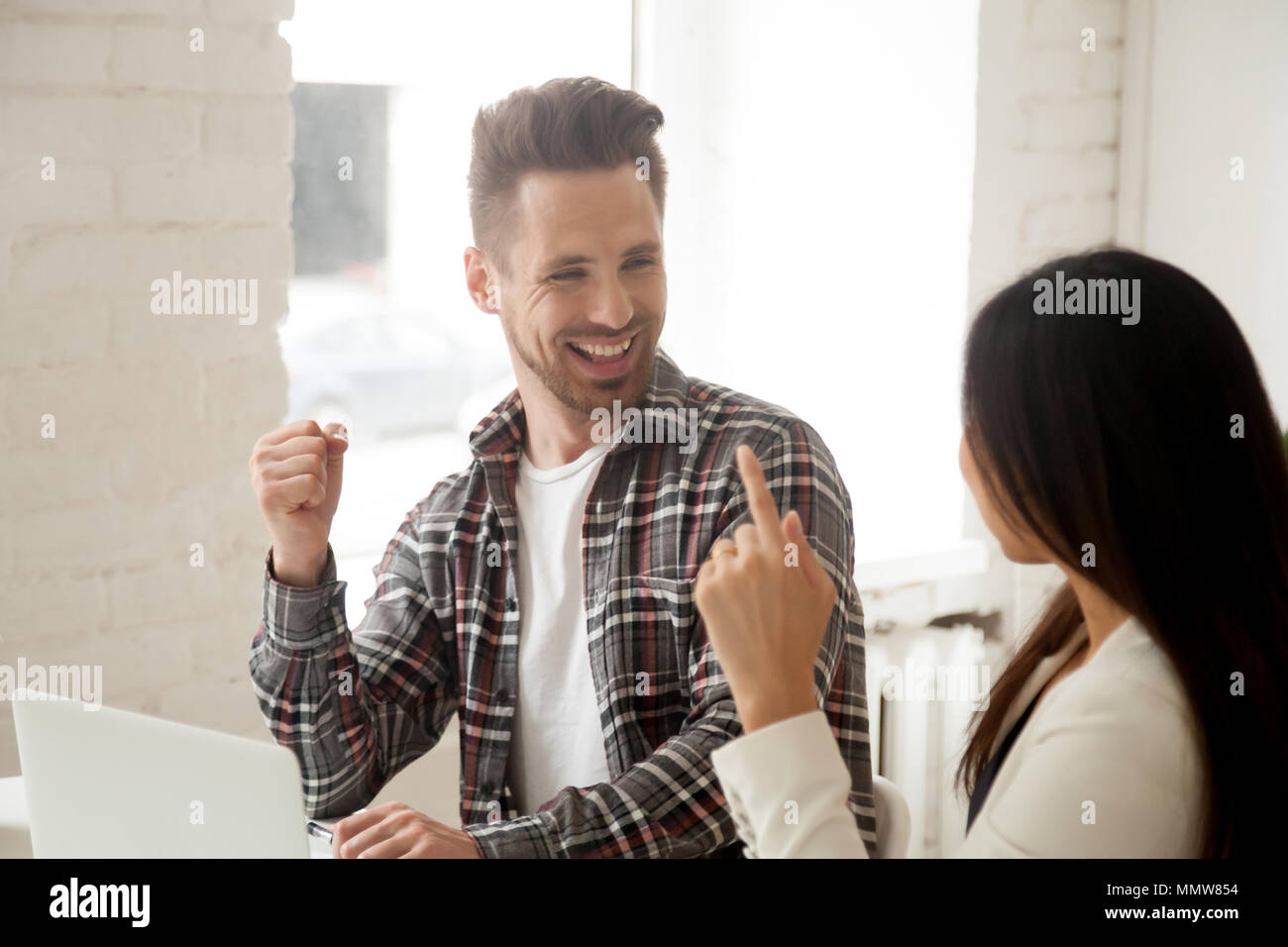 Excited colleagues feeling happy celebrating good teamwork resul - Stock Image