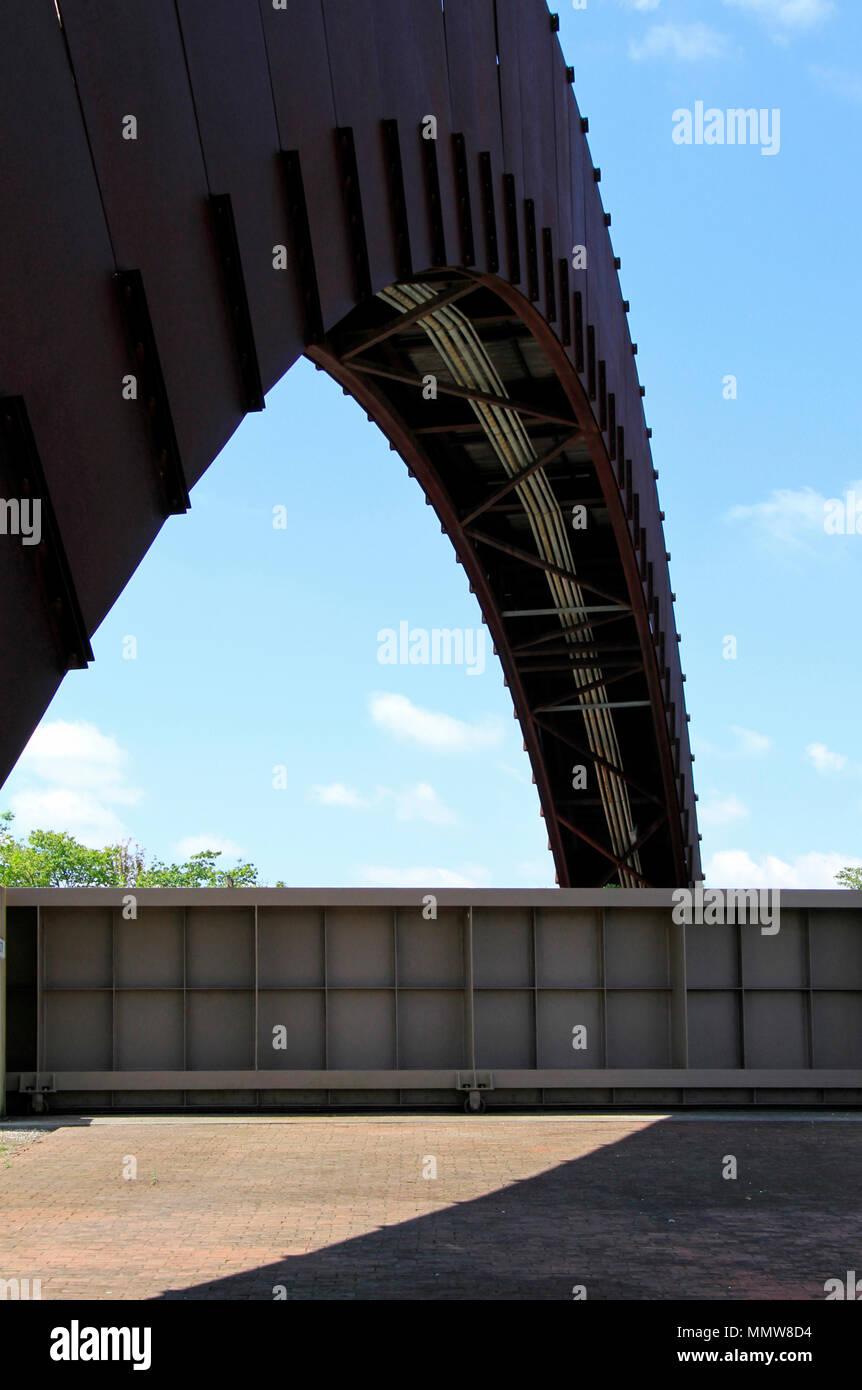 Metal pedestrian bridge crossing a closed gate - Stock Image