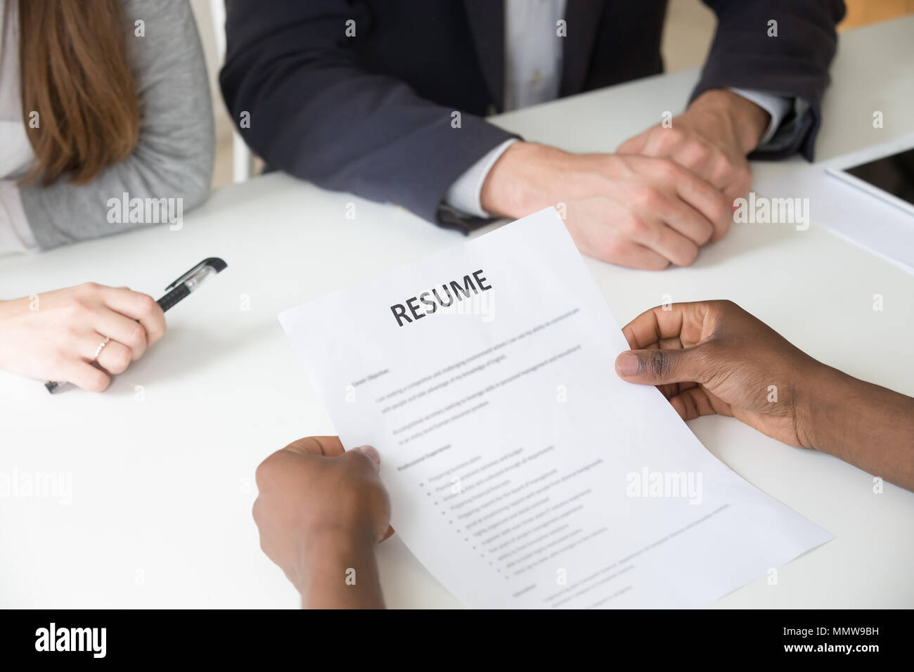 African American Applicant Holding Resume At Job Interview Clos