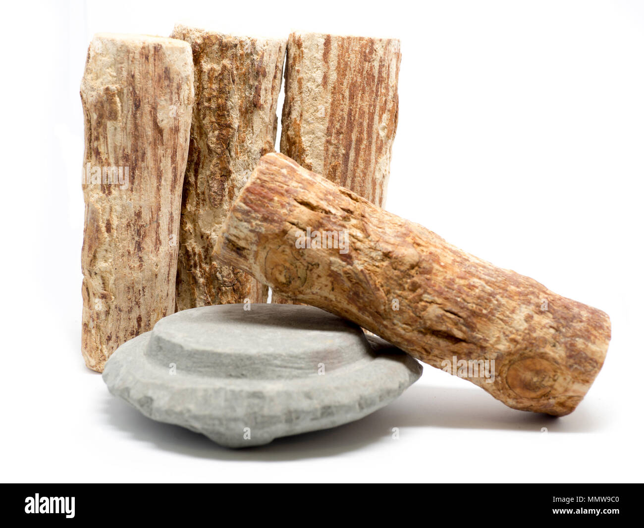Thanaka wood and Kyauk pyin stone slab on white background (Isolated background). The Tanaka is popular with Burmese women. The face to make a beautify - Stock Image