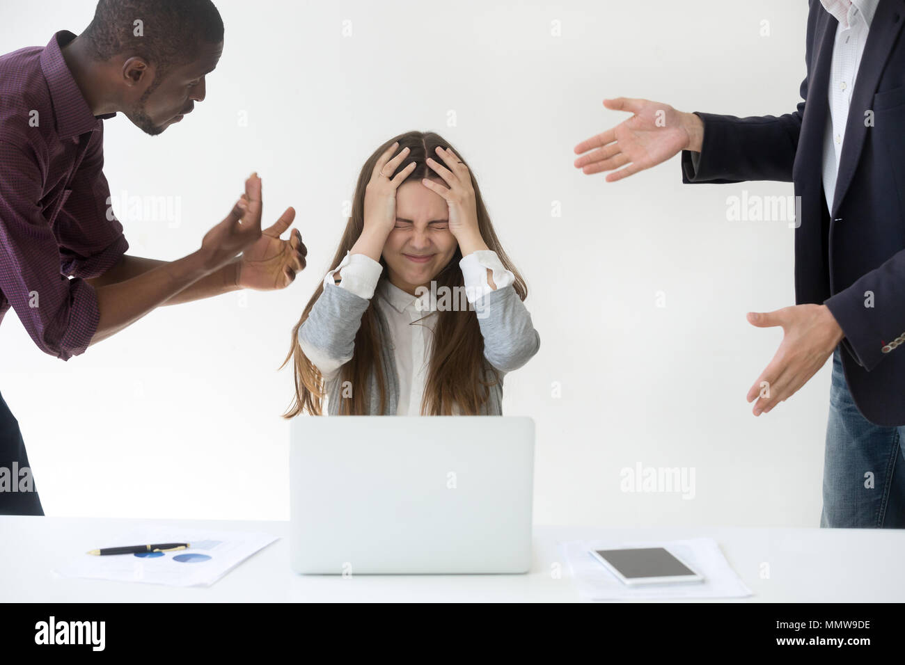 Angry overwhelmed businesswoman stressed about clients complaint - Stock Image