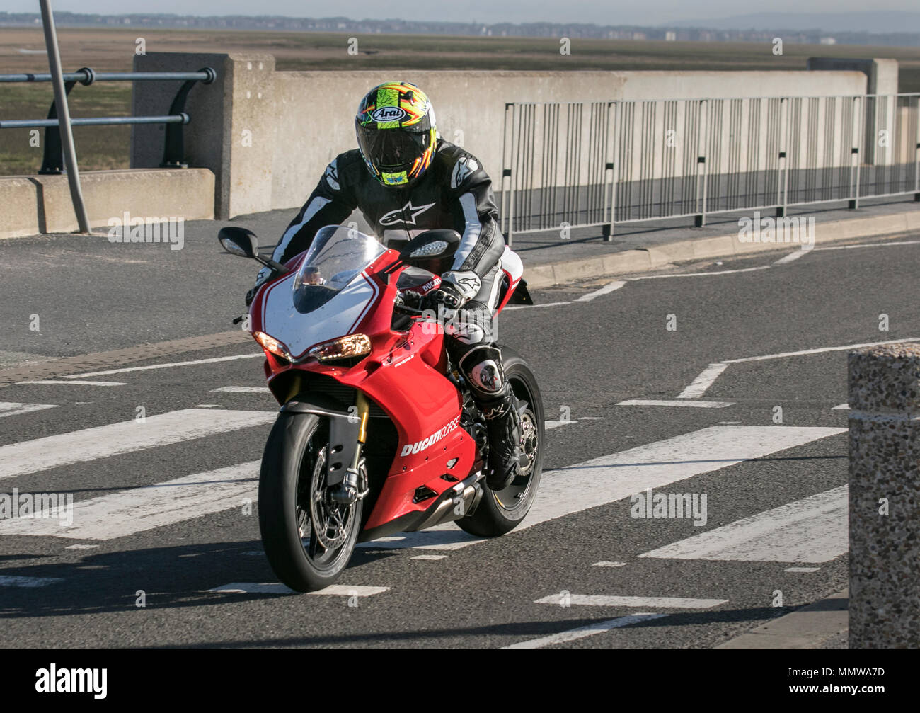 Ducati Panigale R Motorcycle being ridden on Marine Drive, Southport, UK Stock Photo