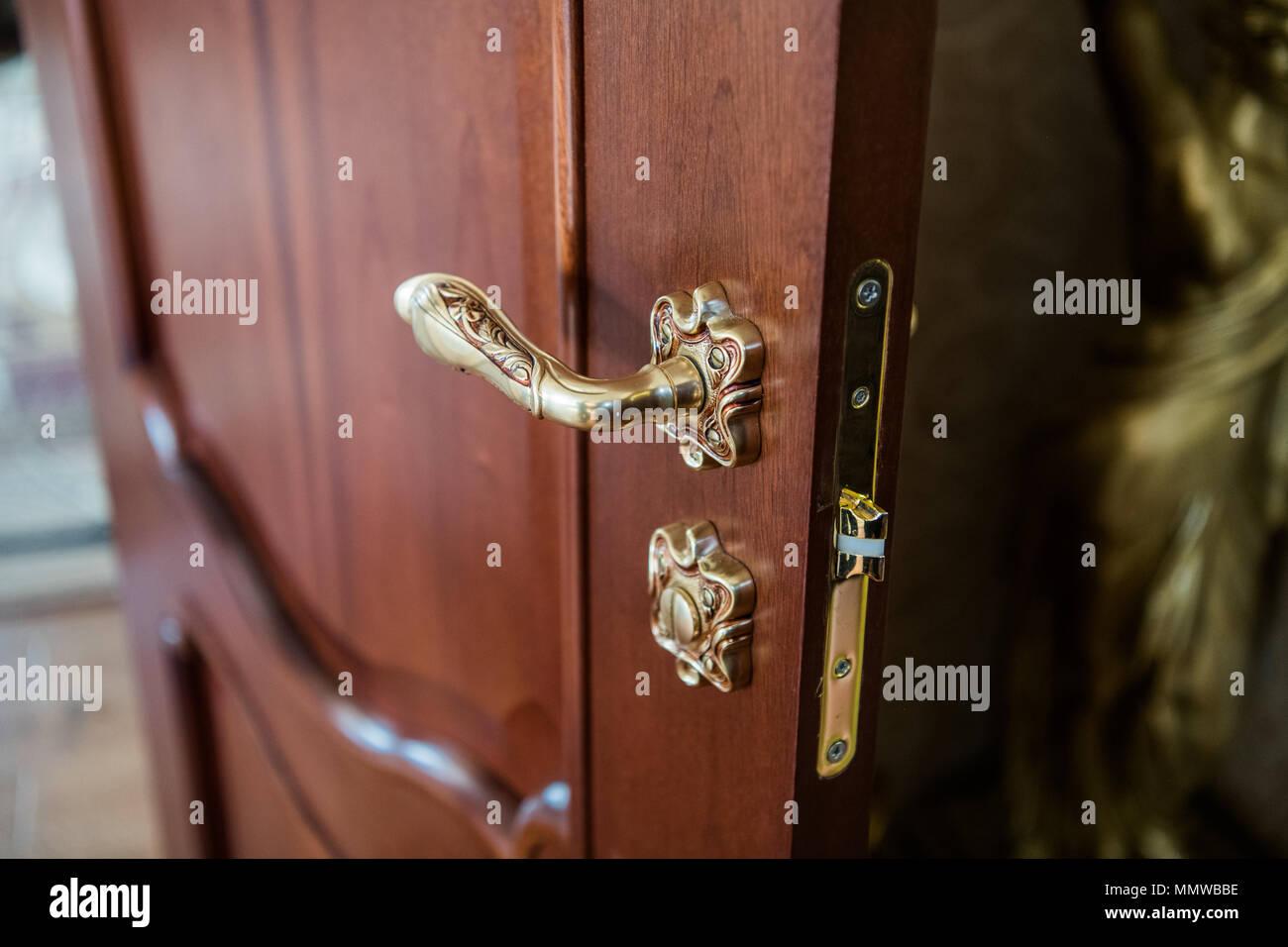 Part of the door. Antique luxury door knob. Elegant handle - Stock Image