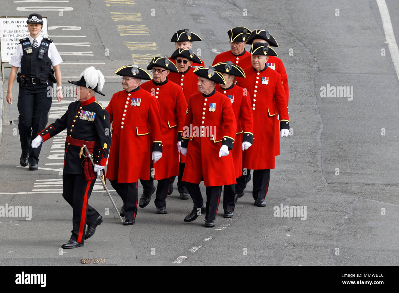 Captain of Invalides No 4 Company Lieutenant Colonel Jonny Lowe MBE leads Chelsea Pensioners at Guernsey's Liberation Day parade. - Stock Image